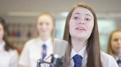4K Young female student singing a solo in school music class Stock Footage