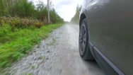 Car wheel spinning POV - Point of View, country side. Forest. Stock Footage