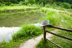 Ranch with wooden fence and cowboy hat Stock Photos