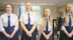 4K Young female students singing together in school music class Stock Footage