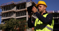 Successful Engineer Worker Browsing Digital Tablet Unfinished Apartment Building Stock Footage