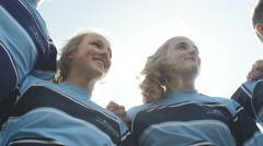 4K Teen group in a huddle on school sports field having team talk before a game Stock Footage