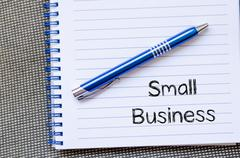 Small business text concept on notebook Kuvituskuvat