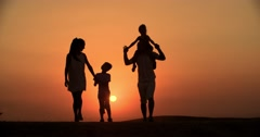 4k silhouette of a family, father mother and two children son and daughter Stock Footage