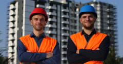 Happy Two Engineers Men Smiling Looking Camera Under Development Tower Building Stock Footage