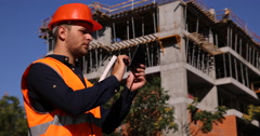 Master Engineer Holding Working with Digital Tablet Under Construction Building Stock Footage