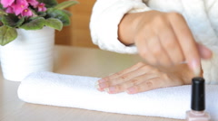 Closeup shot of a beautician applying nail polish to female nail in a nail salon Stock Footage