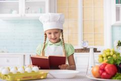 Joyful child is ready to cook Stock Photos
