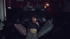 4k Authentic Shot of a Funny Child Watching Horror Movie with Popcorn Stock Footage