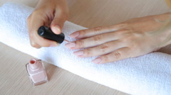 Closeup shot of a beautician applying nail polish to female nail in a nail salon Stock Footage