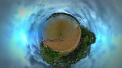Little Tiny Planet 360 Degree Landscape Sandy Bank River Lake or Sea Clouds Are Stock Footage
