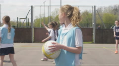 4K Portrait young smiling netball player on outdoor court Stock Footage