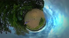 Little Tiny Planet 360 Degree Man on Sandy Bank Walking by the Sea Backpacker Stock Footage