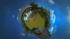 Little Tiny Planet 360 Degree Man Pieces of Wood in Courtyard of Old House Stock Footage