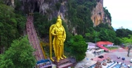 Amazing aerial view of Entrance to Batu Caves with the Murugan statue Stock Footage