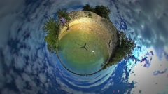 Little Tiny Planet 360 Degree Man at the Sea Turquoise Water Sea Backpacker is Stock Footage