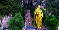 Close view of the Murugan statue and many stairs of entrance to the Batu Caves Stock Footage