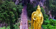 Aerial zooming in view of Entrance to Batu Caves with the Murugan statue Stock Footage