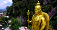 Panoramic aerial view of Murugan statue and many stairs of entrance to Batu Cave Stock Footage