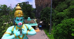 Aerial view of Hanuman statue in Batu Caves and temple dedicated to Lord Hanuman Stock Footage