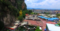 Kuala Lumpur and Batu Caves with the Murugan statue. Aerial Stock Footage