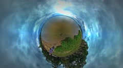 Little Tiny Planet 360 Degree Man is Walking Backpacker by Lake Bank Woodland Stock Footage