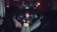 4k Authentic Shot of a Funny Child Watching Movie and Eating Popcorn Stock Footage