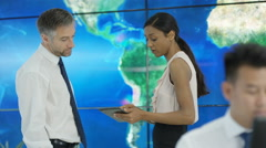 4K Business man & woman looking at world map graphic shake hands on a deal Stock Footage