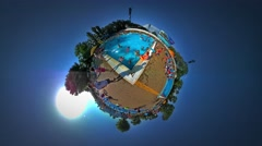 Little Tiny Planet 360 Degree Kids in Aqua Park in Youth Day Opole Sandy Beach Stock Footage