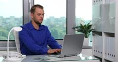 Attractive Businessman Talking Landline Phone Receiving a Negative News Office Stock Footage