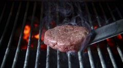 Cooking burger in slow motion Stock Footage