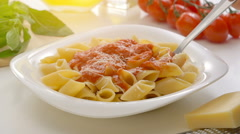 Hot Pasta with tomato Sauce, Parmesan Cheese and Basil on a Spoon Stock Footage