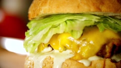 Filled burger in slow motion Stock Footage
