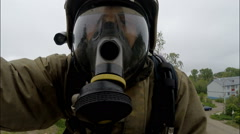 Firefighter climbs the stairs to the car mask Stock Footage