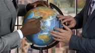 Two businessmen and globe. Stock Footage