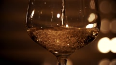 Pouring white wine in slow motion Stock Footage