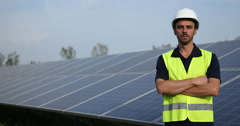Engineer Man Portrait Looking Camera Serious Solar Panel Electricity Production Stock Footage