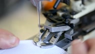 Closeup of tailor sewing buttons on a made to measure shirt. Stock Footage