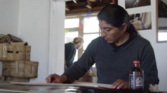 Ecuadorian Artist making leather goods in workshop Stock Footage