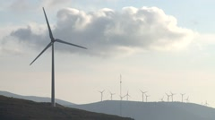 Eolic turbine wind renewable energy farm on top of mountain Stock Footage