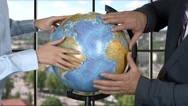 Woman and man with globe. Stock Footage