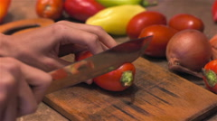 Slicing tomatoes with sharp knife for preservation Stock Footage