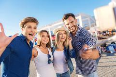 Mates taking a selfie on the beach Stock Photos