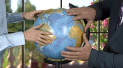 Man and woman with globe. Stock Footage