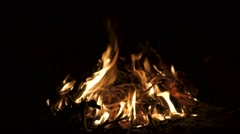 Super slow motion of flame burning in a fireplace with little pieces of wood. Stock Footage