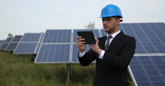 Business Man Using Touchpad Device Checking Solar Panel Electricity Production Stock Footage
