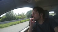Man riding in car and looking through window Stock Footage