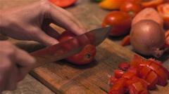 Slicing red tomatoes with sharp knife for preservation. Close up Stock Footage