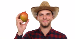 Positive Cultivator Farmer Man Look Camera and Holding Tropical Delicious Mango Stock Footage