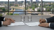 Businessmen signing documents. Stock Footage